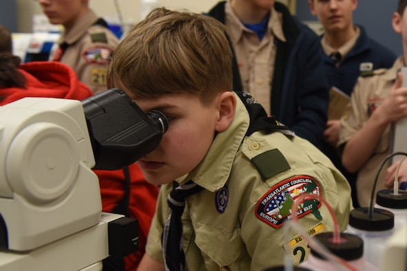 A scout assigned to Boy Scouts of America troop 215 looks at a blood sample through a microscope during a tour of the 48th Medical Group at Royal Air Force Lakenheath, England, Feb. 28, 2020. The troops got the opportunity to speak with U.S. Air Force professionals from several departments and learn about the different medical specialties. (U.S. Air Force photo by Airman 1st Class Jessi Monte)