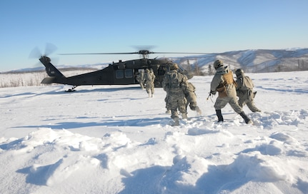 Members of 1st Battalion, 297th Infantry Regiment, Alaska National Guard, based in Fairbanks, Alaska, board a UH-60 Black Hawk helicopter operated by members of 1st Battalion, 169th Aviation Regiment of the New Hampshire National Guard Feb. 28, 2020, in the Yukon Training Area on Eielson Air Force Base as part of exercise Arctic Eagle 2020.