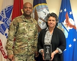Army Lt. Col. Sherdrick Rankin, DLA Troop Support Europe & Africa commander, presents Miriam Tannenbaum, Customer Facing division chief, with the 2019 DLA Troop Support Innovation Award Feb. 19. Tannenbaum was recognized for her innovative efforts to improve warfighter support and encouraging innovation among her team.
