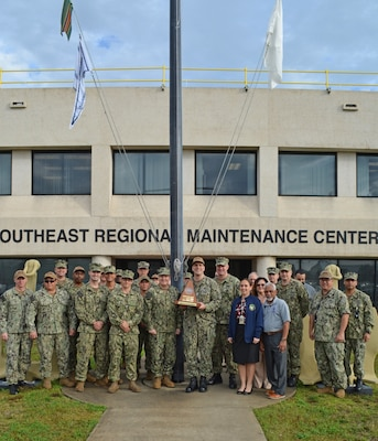 Sailors and Civilians from Southeast Regional Maintenance Center (SERMC) pose with the 2019 Maintenance Award
