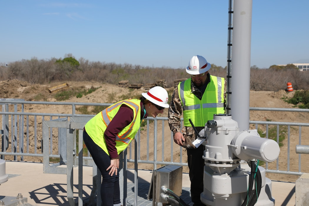 HOUSTON (Feb. 28, 2020)—Alison Pieper, water control manager with the Galveston District Water Management Team and Byron Smith, civil engineer technician with the Houston Project Office inspect an operator on the new water control structures at Barker Dam.  The new structures were placed into use on Feb. 14 as part of a multi-year, $75 million dam safety contract that will improve the robustness, redundancies and resiliency of both Addicks and Barker dams and reservoirs.