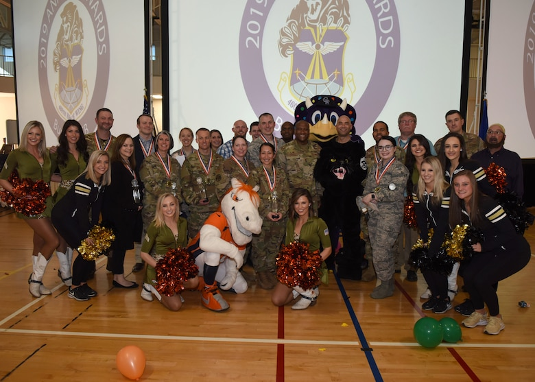 Annual award winners pose with 460th Space Wing leadership and various mascots following the Annual Awards Ceremony at Buckley Air Force Base, Colo., Feb. 28, 2020. The ceremony was designed to have a high-energy feel and include unit participation in recognizing the accomplishments of the annual award winners. (U.S. Air Force photo by Airman 1st Class Haley Blevins)