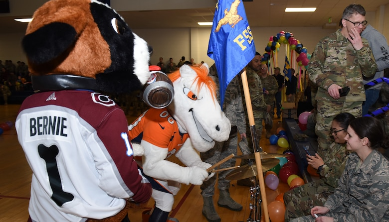 Miles, Denver Broncos mascot, plays the drums during the Annual Awards Ceremony in the Buckley Fitness Center at Buckley Air Force Base, Colo., Feb. 28, 2020. The ceremony was designed to have a high-energy feel and include unit participation in recognizing the accomplishments of the annual award winners. (U.S. Air Force photo by Airman 1st Class Haley N. Blevins)