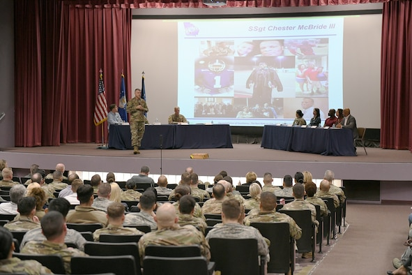 Col. Brian Moore, 78th Air Base Wing commander, Robins Air Force Base, Ga., addresses attendees during the Robins Proud Forum at the base theater, Feb. 25, 2020. Col. Moore told the heroic story of Office of Special Investigations Special Agent Chester McBride during the event. The commander recognizes local Gold Star families and their loved ones during the monthly gatherings. The forums allow leadership and subject matter experts to communicate face-to-face and interact with Team Robins members on topical issues, such as resiliency and readiness. (U.S. Air Force photo by Rodney Speed, 78 ABW/PA)