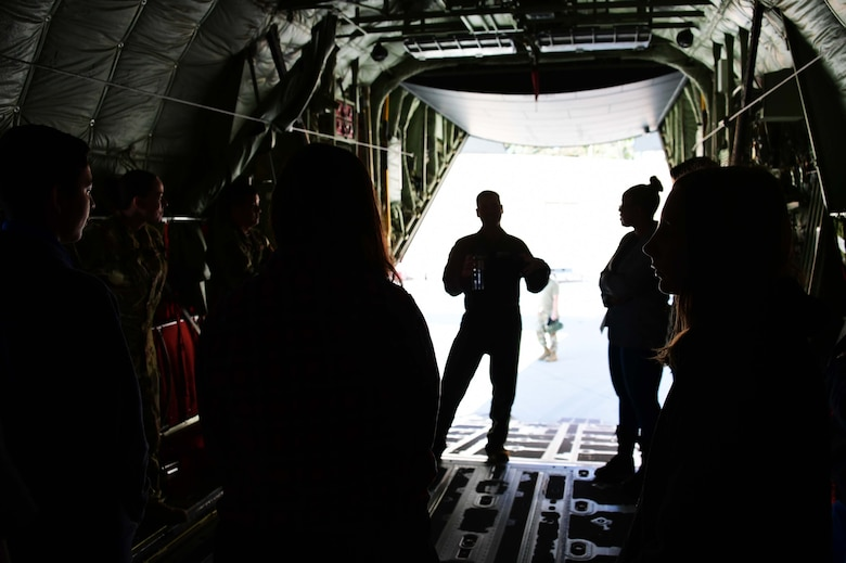 Photo of Col. Keith Ward speaking to students on the back of a C130-J.