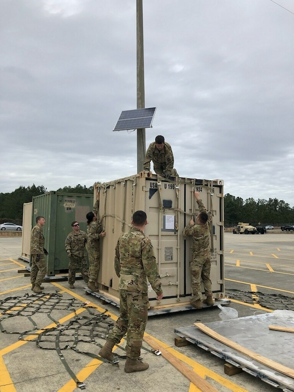 EAGLE team members properly secure a container to a 463L pallet using top and side netting at Pope Army Airfield, N.C., Jan. 10, 2020. The EAGLE team provided support for the 82nd Airborne Division's Immediate Response Force deployment to the Middle East.