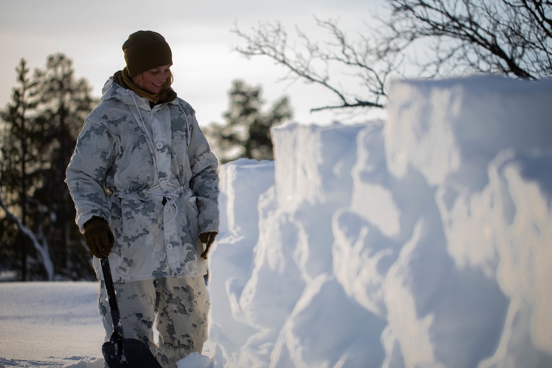 A U.S. Marine builds a snow wall during cold-weather training near Bjerkvik, Norway, Feb. 23.