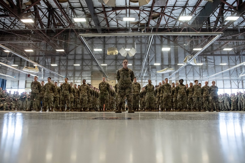 Airmen assigned to the 20th Aircraft Maintenance Squadron (AMXS) stand at parade rest awaiting the reorganization of the squadron during a squadron stand-up ceremony at Shaw Air Force Base, South Carolina, Feb. 24, 2020.