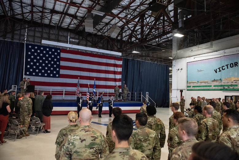 The 20th Force Support Squadron honor guard hoists the colors while the national anthem plays during a squadron stand-up ceremony at Shaw Air Force Base, South Carolina, Feb. 24, 2020.