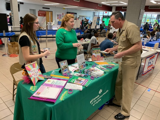 "IMAGE: SPOTSYLVANIA, Va. (Feb. 29, 2020) – Capt. Casey Plew, Naval Surface Warfare Center Dahlgren Division (NSWCDD) commanding officer, talks with members of the Girl Scouts of the Commonwealth of Virginia at the annual science, technology, engineering, mathematics (STEM) Summit hosted by Chancellor High School. Plew was among the NSWCDD leaders, scientists and engineers who joined a myriad of organizations to engage students with science, technology, engineering, mathematics (STEM) demonstrations. ""With new programs in outdoor adventure and STEM and the promise of dozens of new skills to learn and awards to earn, at Girl Scouts the trail is yours to blaze,"" according to the organization's website. (U.S Navy photo/Released)"