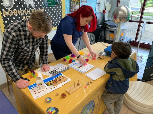 IMAGE: SPOTSYLVANIA, Va. (Feb. 29, 2020) – Science, technology, engineering, mathematics (STEM) mentors from Naval Surface Warfare Center Dahlgren Division (NSWCDD)  use Soma blocks to pique an elementary school student's interest in STEM at the annual science, technology, engineering, mathematics (STEM) Summit hosted by Chancellor High School. They were among the NSWCDD leaders, scientists and engineers who joined a myriad of organizations to engage students with STEM technologies and demonstrations. (U.S. Navy photo/Released)