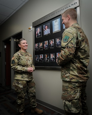 Chief Master Sgt. Stacy Wilfong, Headquarters Readiness and Integration Organization command chief, talks to Master Sgt. Kevin Wilson, noncommissioned officer in charge of installation personnel readiness at RIO, in the hallway of RIO, March 3, 2020. Wilfong was selected in February to be HQ RIO's command chief and began her duties March 2. (U.S. Air Force photo by Master Sgt. Leisa Grant/Released)