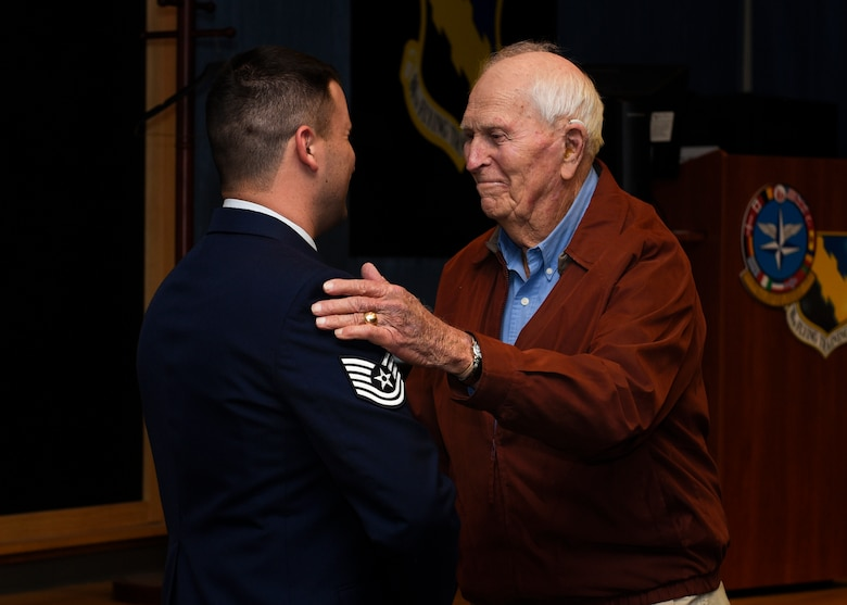Tech. Sgt. Joe Jones and his grandfather U.S. Army Capt. (Ret) Joe Jones, shake hands at Sheppard Air Force Base, Texas, Feb. 28, 2020. Jones invited his grandfather to see him promote in person for the first time. In a monologue, Jones stated he did not think he would make it this far in his career, considering his decisions before joining the Air Force. His grandfather jokingly said he also did not think Jones would make it, but then said he is proud of his grandson for being in the Air Force. (U.S. Air Force photo by Senior Airman Pedro Tenorio)