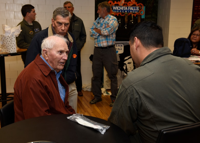 U.S. Army Capt. (Ret) Joe Jones and his son Jim Jones, talk with 80th Flying Training Wing members at Sheppard Air Force Base, Texas, Feb. 28, 2020. Jones is a World War II veteran and served in Gen. George Patton's Third Army. He was first a rifle platoon leader and later a weapons platoon leader (in charge of three 30. cal machine guns and three 60 mm mortars.) Jones has seen combat in France and Germany. (U.S. Air Force photo by Senior Airman Pedro Tenorio)