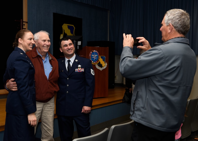 From left, Lt. Col Elia Hickie, retired Army Capt. Joe Jones and Tech. Sgt. Joe Jones, pose while Ken Jones takes a photo at Sheppard Air Force Base, Texas, Feb. 28, 2020. This was Jones' family's first time seeing him promote since basic training. To become a Tech. Sgt., not only must you be proficient and have a craftsman skill level in your career field, there are multiple Air Force standard tests you must score well on. Not to mention competing with every other Staff Sgt. looking to promote as well. (U.S. Air Force photo by Senior Airman Pedro Tenorio)