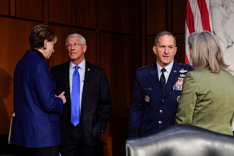 Air Force Secretary Barbara M. Barrett and Chief of Staff Gen. David L. Goldfein, second from right, speak with members of the Senate Armed Services Committee before testifying on the posture of the Air Force at the Hart Senate Office Building in Washington, D.C., March 3, 2020. (U.S. Air Force photo by Wayne Clark)