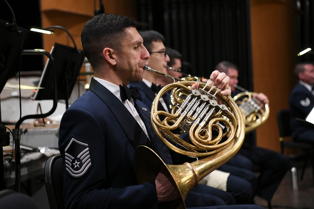 Master Sgt. David Balandrin, U.S. Air Force Concert Band French hornist, performs during the Guest Concert Series at the Rachel M. Schlesinger Concert Hall and Arts Center in Alexandria, Va., Feb. 20, 2020. The band has five assigned French horn players and over 15 different instruments apart of the ensemble. (U.S. Air Force photo by Airman 1st Class Spencer Slocum)