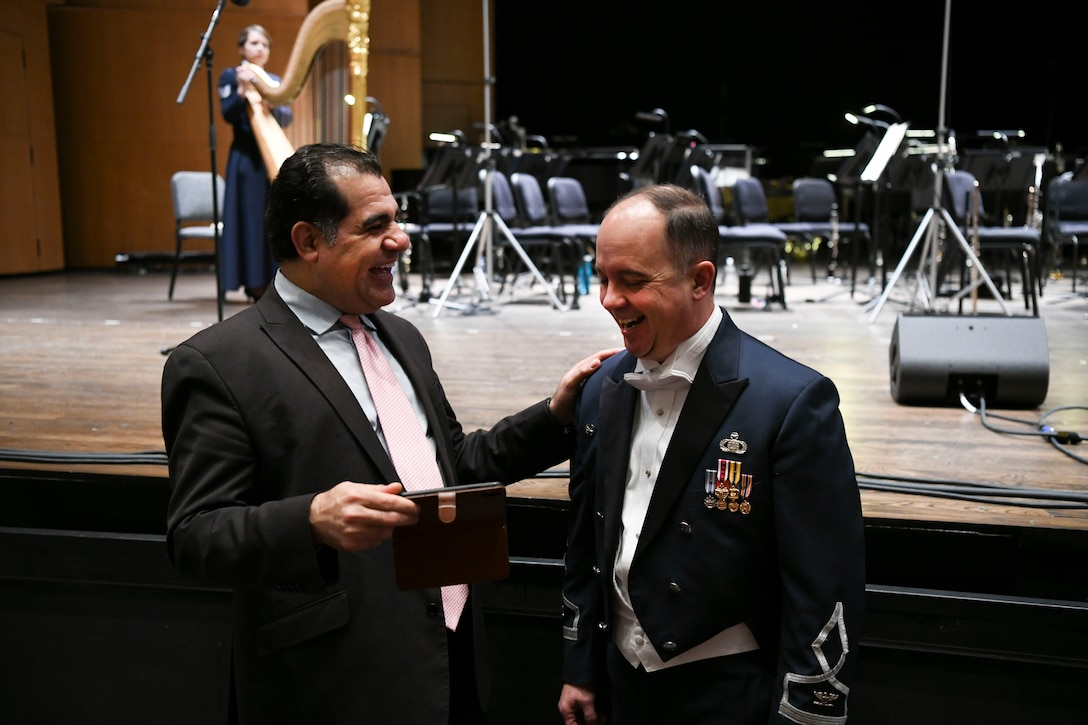 Col. Don Schofield, The United States Air Force Band commander and conductor, shares a laugh with a concert attendee before the Guest Concert Series at the Rachel M. Schlesinger Concert Hall and Arts Center in Alexandria, Va., Feb. 20, 2020. The concert featured the United States Air Force Concert Band, members of the Singing Sergeants and their guest performer, Samantha Massell. (U.S. Air Force photo by Airman 1st Class Spencer Slocum)