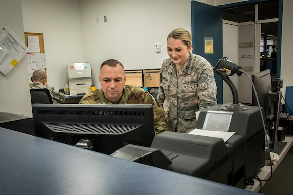 Military members view information on a computer
