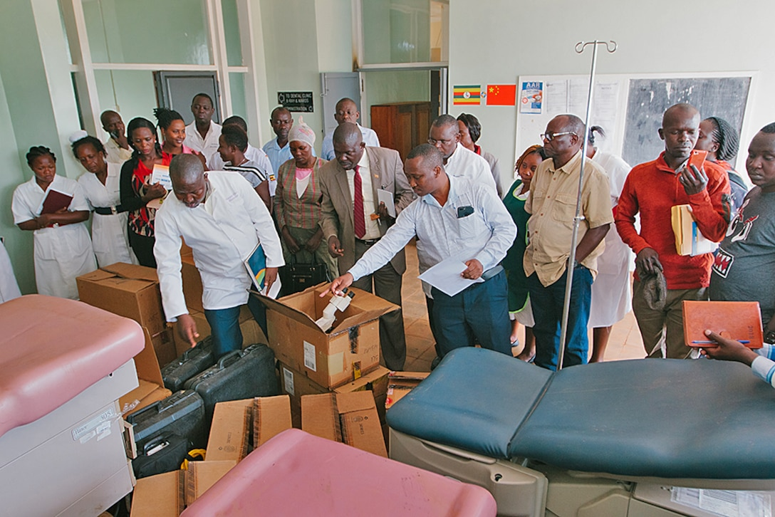 Doctors look at donated equipment