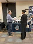 Jay Hilderbran speaks with OSU candidate about career opportunities at DLA.