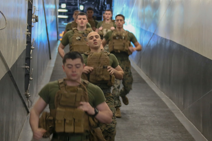 200207-M-IR130-2037 U.S. 5TH FLEET AREA OF OPERATIONS (Feb. 7, 2020) Marines assigned to Fox Company, Battalion Landing Team, 2nd Battalion, 8th Marine Regiment, 26th Marine Expeditionary Unit (MEU), run aboard the amphibious assault ship USS Bataan (LHD 5). Bataan Amphibious Ready Group, with embarked 26th MEU, is deployed to the U.S. 5th Fleet area of operations in support of maritime security operations to reassure allies and partners and preserve the freedom of navigation and the free flow of commerce in the region. (U.S. Marine Corps photo by Lance Cpl. Gary Jayne III)