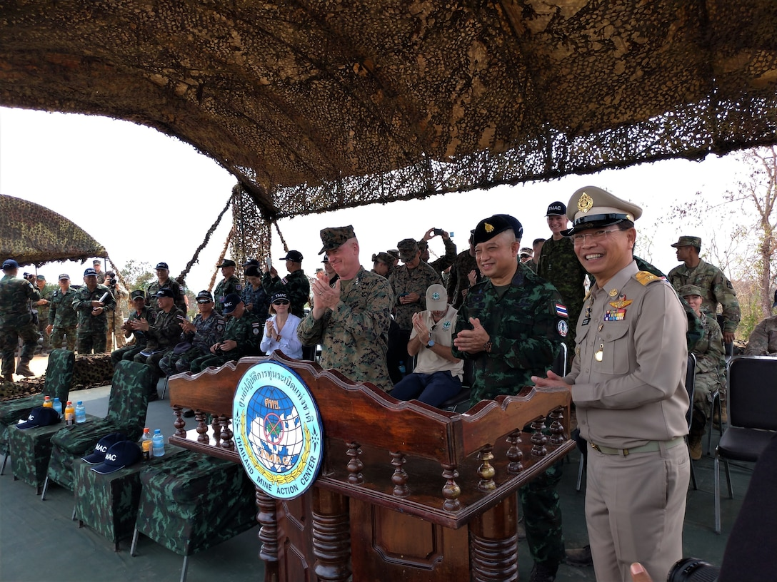From left to right, U.S. Marine Lt. Gen. Stacy Clardy, the III Marine Expeditionary Force commanding general, Thai Army Lt. Gen. Sittipol Nimnuan, director general of the Royal Thai Armed Forces Thai Mine Action Center, and the RTAF Deputy Chief of Staff Gen. Pariphat Phalasin celebrate after detonating a group of recovered landmines at a landmine reduction event during Cobra Gold 2020 at Watthana Nakjon, Sa Kaeo, Kingdom of Thailand, March 3.