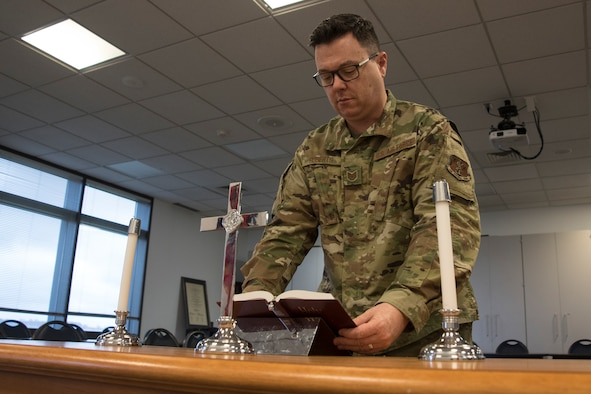 Military member prepares a bible for church service
