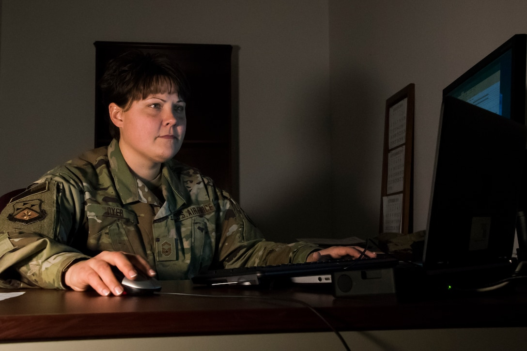 Military member works on a computer