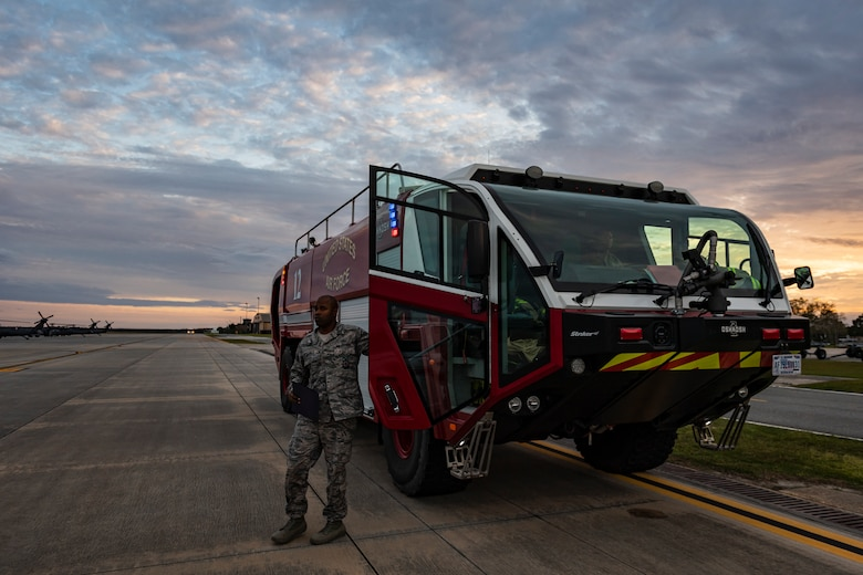 A photo of an Airman stepping out of a firefighting vehicle