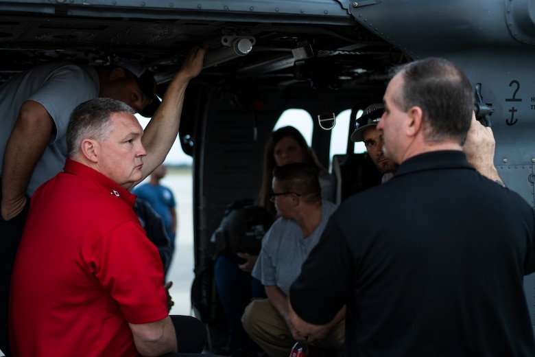 A photo of a local fire chief listening to a brief