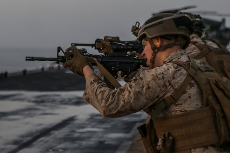 200301-M-KE756-1028 GULF OF OMAN (March 1, 2020) Pfc. Chad Burke, a rifleman assigned to Fox Company, Battalion Landing Team, 2nd Battalion, 8th Marine Regiment, 26th Marine Expeditionary Unit (MEU), fires an M4A1 carbine during a live-fire training range aboard the amphibious assault ship USS Bataan (LHD 5) March 1, 2020. Bataan, with embarked 26th MEU, is deployed to the U.S. 5th Fleet area of operations in support of naval operations to ensure maritime stability and security in the Central Region, connecting the Mediterranean and Pacific through the Western Indian Ocean and three strategic choke points. (U.S. Marine Corps photo by Cpl. Tanner Seims)