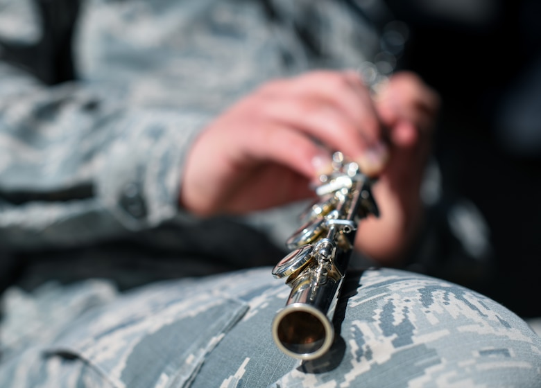 Senior Airman Richard Elefson, an 11th Space Warning Squadron mission management operator, holds his flute, Jan. 10, 2020, at the chapel on Buckley Air Force Base, Colo.