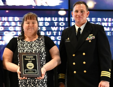 IMAGE: Sue Limerick is the Naval Surface Warfare Center Dahlgren Division featured employee for Women's History. Limerick is pictured with Capt. Plew during the honorary awards ceremony in May 2019.