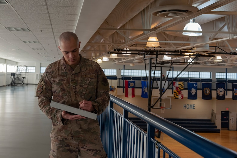 Photo of Airman recording head count results