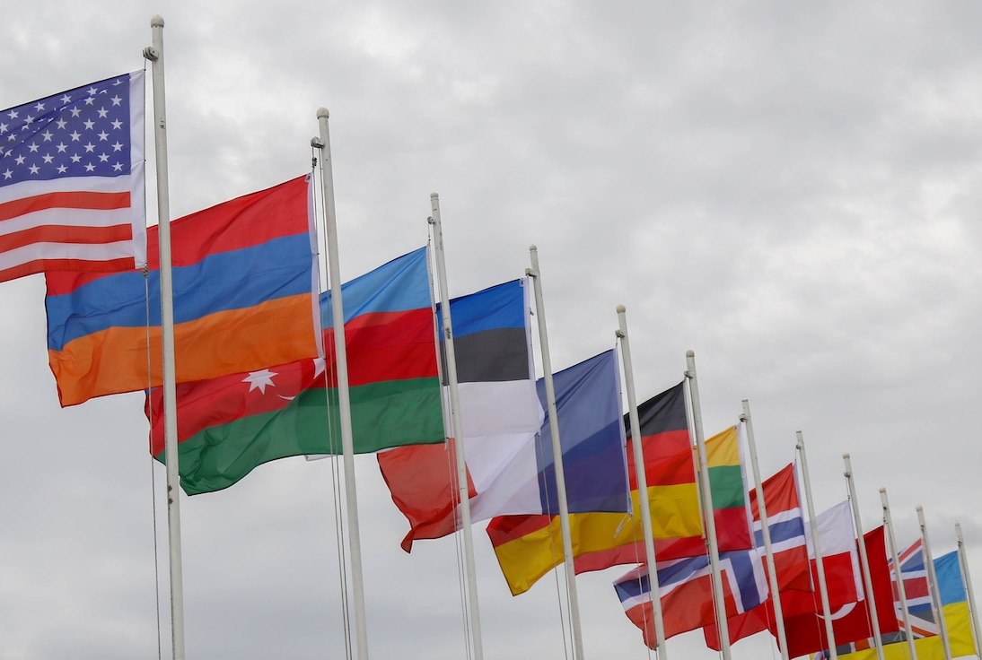 The flags of the 13 allied and partner nations which participated in Noble Partner 18 are presented during the exercise's closing ceremony at Vaziani Training Area, Georgia, Aug. 15, 2018. Noble Partner 18 was a cooperatively-led multinational training exercise in its fourth iteration which supported the training of Georgian Armed Forces' mechanized and Special Operation Forces, U.S. Regionally Aligned Forces, the U.S. Army and Air National Guard from the state of Georgia, and 11 other participating nations. (U.S. Army photo by Sgt. Kris Bonet, 180815-A-CI827-006)