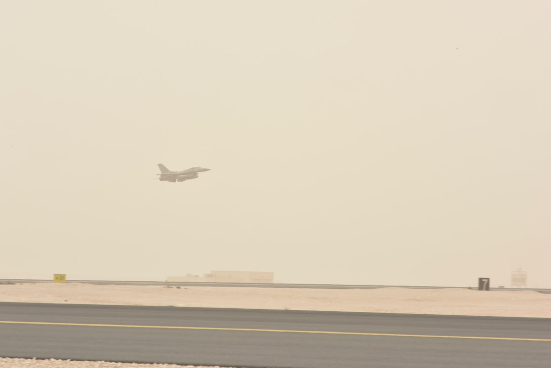 """An F-16 Fighting Falcon with the 555th Fighter Squadron, also known as the """"world famous, highly-respected"""" Triple Nickel, takes off at Al Udeid Air Base, Qatar on Feb. 26,  2020. While deployed to AUAB, the Triple Nickel flew more than 840 sorties and nearly 5,000 hours in less than 120 days, directly supporting combat operations for Operations Spartan Shield and Inherent Resolve. (U.S. Air Force photo by Tech. Sgt. John Wilkes)"""