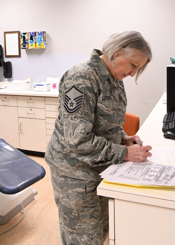 Master Sgt. Terrylee Crowther, 104th FW Dental Assistant keeps medical paperwork and records for Airmen. As the NCOIC of Dental at the 104th Fighter Wing, she ensures members are up to date on dental screenings so they can stay deployment ready. (U.S. Air National Guard Photo by Airman Camille Lienau)