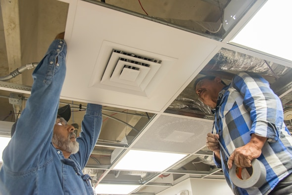 Contractors working on the Child Development Center kitchen renovation install a vent at Laughlin Air Force Base, Texas, March 3, 2020. The new renovation comes with an expanded workspace, new cabinets and appliances, and more ease of use for the faculty.