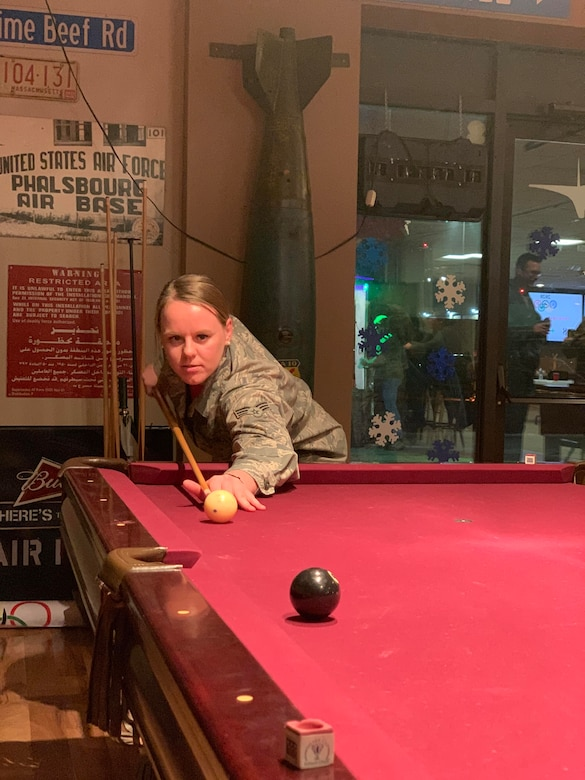 Members of the 104th Fighter Wing took part in the 104th Fighter Wing's Enlisted vs. Officers Olympics, Feb. 1, 2020. Airmen of all ranks participated in a friendly competition of darts, shuffleboard, corn hole, foosball, giant Jenga, flip cup, and pool to bring the wing's team members together for camaraderie. (U.S. Air National Guard photo by Senior Master Sgt. Julie Avey)