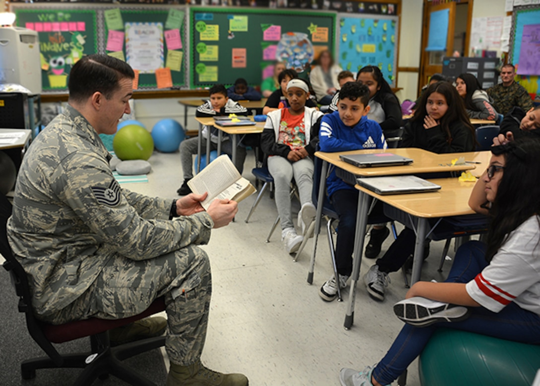 DLA Aviation military member reads to elementary school students
