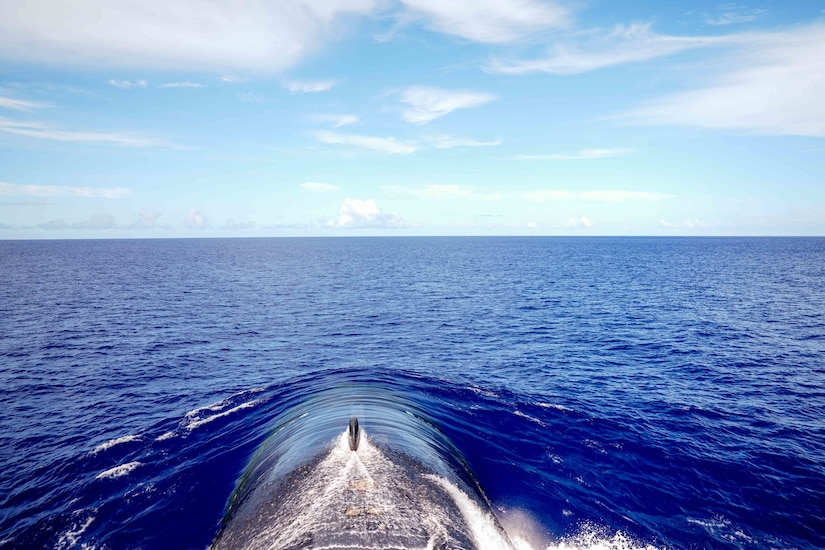 A submarine emerges from the water.