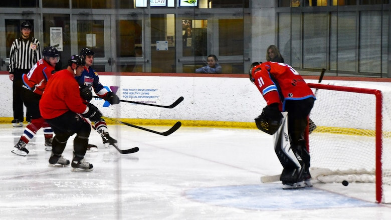 Senior Airman Nick Burns, 104th Fighter Wing Barnestormer player, scores a goal against the Springfield Thunderbirds Charity team in a game to raise money for an organization aimed at spreading awarness for veteran suicide Feb. 2, 2020, in Westfield, Massachusetts. The hockey game built camaraderie amongst Airmen and allowed them with an opportunity to support military veterans. (U.S. Air National Guard photo by Airman 1st Class Sara Kolinski)