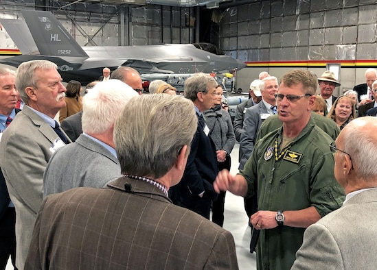 Col. Brian Silkey, 419th Fighter Wing vice commander, explains the F-35A Lightning II to a group of local and national community leaders