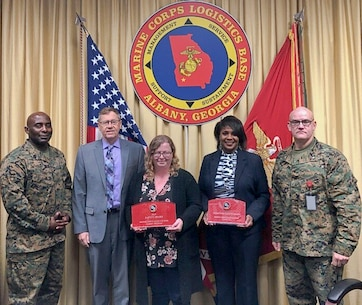 From left to right, Marine Corps Logistics Base Albany Sgt. Maj. Jeffrey Young, Executive Director Leonard Housley and Executive Officer Lt. Col. Joseph Ray hand out awards during the Commanding Officer's Safety Council Feb. 19. Award recipients from left to right, MCCS Safety Officer Alisha Montieth and MCCS Director Deborah Bouyer received the CO's Safety Division CY19 Award for the 4th Quarter and the CY19 Award of the Year. (U.S. Marine Corps by Juan Escovar)