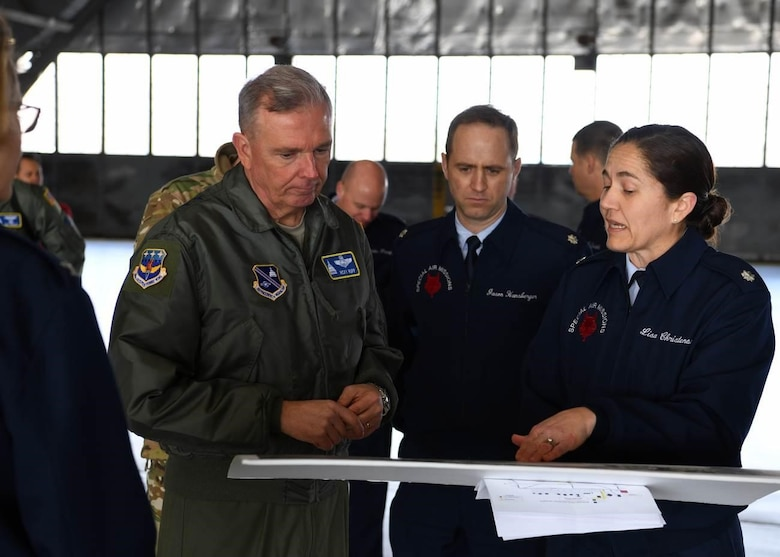Lt. Col. Lisa Christensen, 89th Operations Support Squadron commander, right, briefs the capabilities of the C-32A aircraft to Maj. Gen. Ricky N. Rupp, Air Force District of Washington and 320th Air Expeditionary Wing commander, left, during an 89th Airlift Wing Immersion Tour on Joint Base Andrews, Maryland, Feb. 28, 2020. During the tour, Rupp, and other leaders of AFDW and the 11th Wing received a wing mission briefing, visited the wing's communication and aerial port squadrons, and a toured a of the C-32A aircraft. (U.S. Air Force photo by Tech. Sgt. Kentavist P. Brackin)