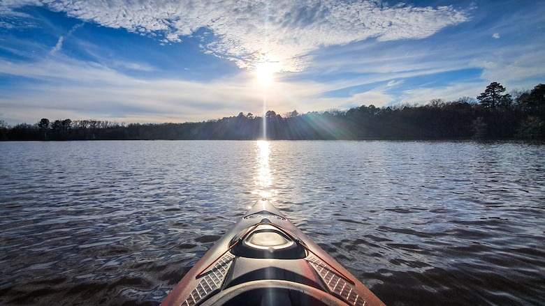 The sun hangs above the horizon at Flag Lake located at Barksdale Air Force Base, La. Feb. 22, 2020. Outdoor Recreation has all of the equipment to allow anyone to rent kayaks, canoes, fishing gear, camping equipment and more.