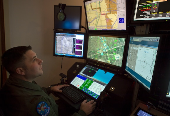 Image of an Airman operating a simulator.