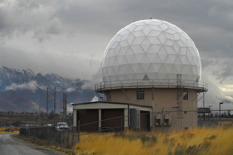 The AN/FPS-117 engineering facility at Hill Air Force Base with the snow-capped Wasatch Mountains in the background.