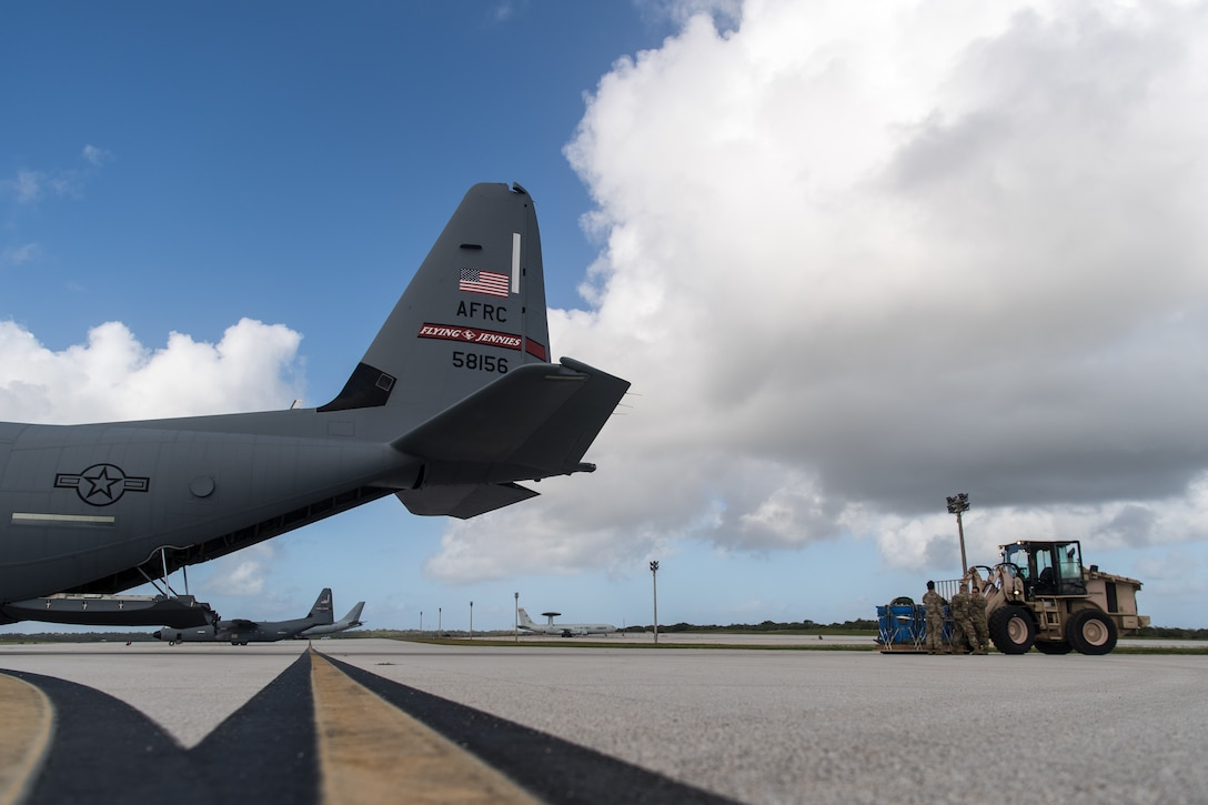 Airmen assigned to the 815th Airlift Squadron, Keesler Air Force Base, Mississippi, load container delivery systems onto a C-130J Hercules to be airdropped over Tinian during Exercise Cope North 20, Feb. 24, 2020, Andersen Air Force Base, Guam. Cope North 20 is an annual trilateral field training exercise conducted at Andersen Air Force Base, Guam, and around the Commonwealth of the Northern Mariana Islands (CNMI), Palau and Yap in the Federated States of Micronesia. (U.S. Air Force photo by Senior Airman Gracie Lee)